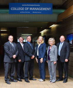 Michael Roche (right), the SSCF director at the Defense Acquisition University, joins members of the new class, (L-R) Jack Spielman, John Engbloom, Anthony Budzichowski, Marta Tomkiw, and Deborah DiCesare.