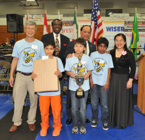 The Hoben iTerrifics team from Canton won the Junior Game competition at the Robofest World Championships. In the back are (L-R) coach Hoa Pham, Lego Education representative Ivery Toussant, LTU President Virinder Moudgil and Toyota representative Yan Liu. In the front are Amin Jazaeri, Thien Pham and Noah Joseph.