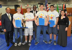 The NCA Lights team from Northville won the Senior Game competition at the Robofest World Championships. From left to right are LTU President Virinder Moudgil, Ben Lenze, Alex Perry, Lego Education representative Ivery Toussant, Bryan Brauchler, Nick Nunu and Toyota representative Yan Liu.