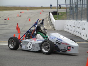 Lawrence Tech's Formula Hybrid racing vehicle makes a turn at the New Hampshire Motor Speedway.