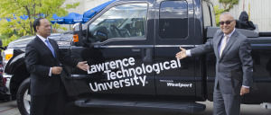 LTU President Virinder Moudgil (L) and ServoTech Engineering President Hamid Servati unveil the logos on one of the trucks donated by Westport Advanced Engineering.